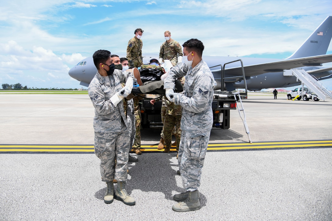 Airmen from the 45th Operational Medical Readiness Squadron, offload a patient July 10, 2020, at Patrick Air Force Base, Florida. The patients had recently returned from overseas to their home stations for follow-on care. (U.S. Air Force photo by Airman 1st Class Nilsa Garcia)