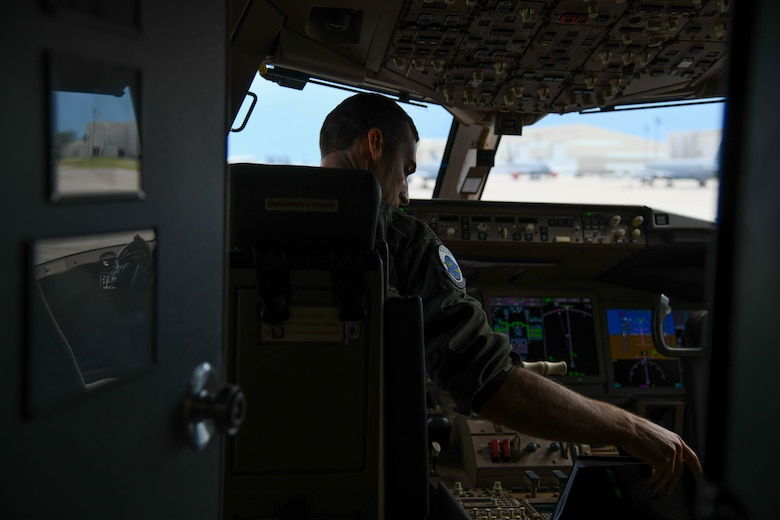 Maj. Michael Murphy, 905th Air Refueling Squadron pilot, conducts a preflight check July 9, 2020, at McConnell Air Force Base, Kansas. Murphy was part of a seven-man aircrew team that participated in a total force initiative to test capabilities of aeromedical evacuation on the KC-46A Pegasus. The mission marked the first aeromedical evacuation of live patients to be carried out by the KC-46. (U.S. Air Force photo by Airman 1st Class Nilsa Garcia)
