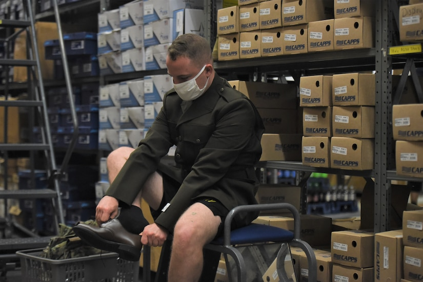 male Soldier trying on a new pair of dress shoes.