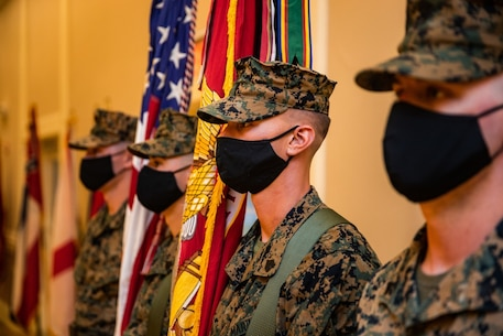 U.S. Marines with 2d Battalion, 6th Marine Regiment, color guard stand at attention during a change of command ceremony on Camp Lejeune, North Carolina, July 9, 2020. The ceremony represents the transfer of authority, responsibility, and accountability from the out-going officer to the incoming commanding officer. (U.S. Marine Corps photo by Lance Cpl. Patrick King)