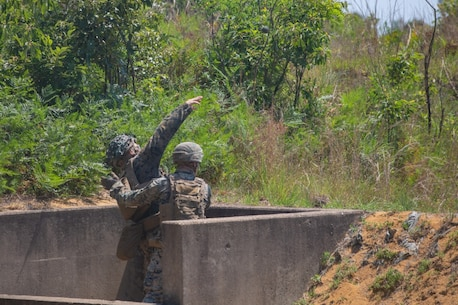 A U.S. Marine with 2d Battalion, 2d Marine Regiment (V22), 2d Marine Division, throws a grenade during a range at Fort A.P. Hill, Virginia, July 12, 2020. Marines with V22 are training in a simulated realistic setting and environment to improve combat effectiveness and readiness. (U.S. Marine Corps photo by Lance Cpl. Reine Whitaker)