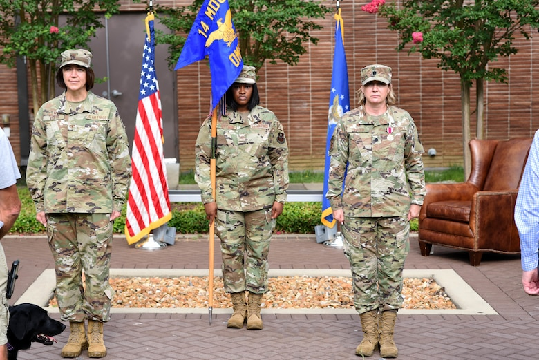 Col. Betty Venth (left), 14th Medical Group commander, and Lt. Col. Tracy Snyder (right), former 14th OMRS commander, stand at attention July 16, 2020, at a change of command on Columbus Air Force Base, Miss. The 14th OMRS has the responsibility for preventive, integrated health care through mental health, public health, physical therapy, optometry and health and wellness activities for Columbus AFB. (U.S. Air Force photo by Senior Airman Jake Jacobsen)