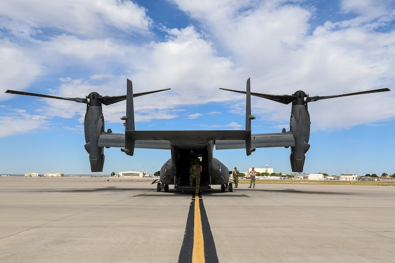 Maintainers do pre-flight checks on CV-22 Osprey.