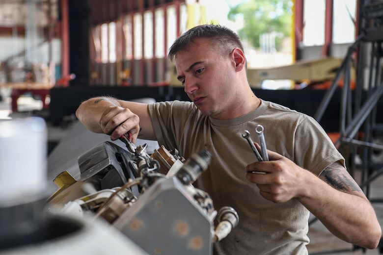 Maintainer works on a CV-22 propeller blade.