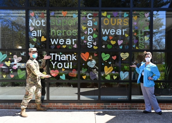 Army 2nd Lt. Justin Lee, a platoon leader assigned to the 104th Medical Company Area Support, Maryland National Guard, poses April 9, 2020, with Celia Goughenour, the director of nursing for Crofton Care and Rehabilitation Center in Crofton, Maryland.