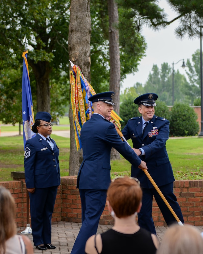 Col. Seth Graham, 14th Flying Training Wing commander, hands Col. Jeffery Welborn, 14th Mission Support Group commander, the 14th MSG guidon at the 14th MSG change of command ceremony on July 13, 2020, at Columbus Air Force Base, Miss. The 14th MSG maintains facilities and infrastructure for a 6,013-acre pilot training base and provides contracting, law enforcement, supply, transportation, fire protection, communications, education, recreation and personnel management. (U.S. Air Force photo by Airman 1st Class Davis Donaldson)
