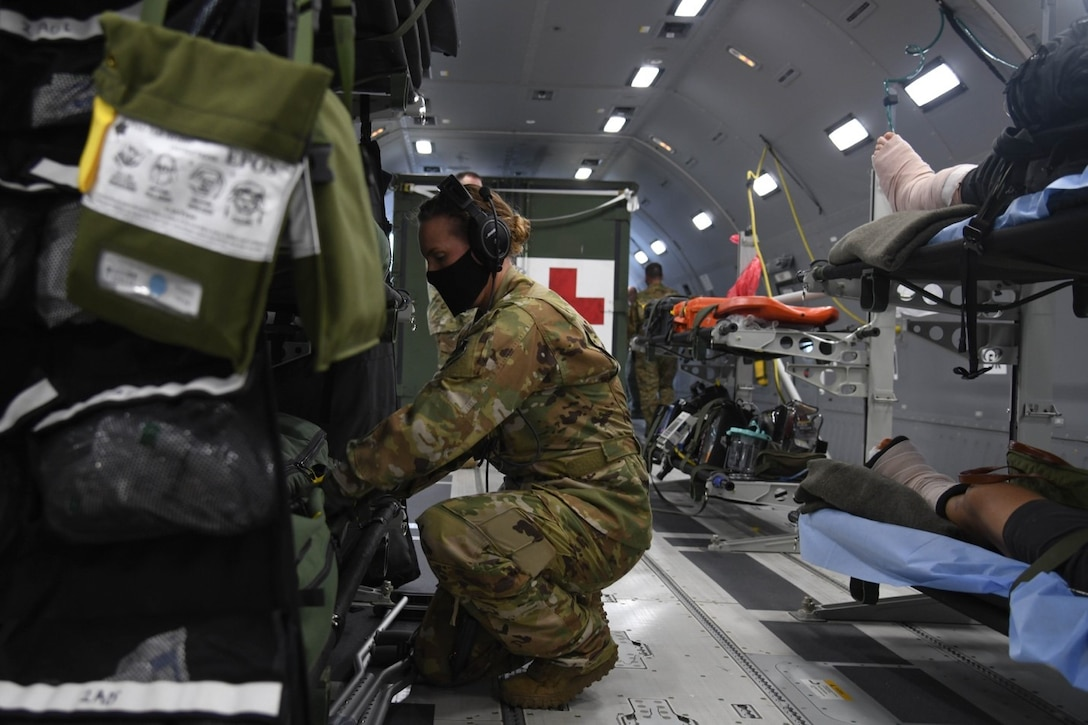 U.S. Air Force Master Sgt. Jaclyn Klimaski, Air Mobility Command aeromedical evacuation technician assigned to Air Mobility Command Headquarters at Scott Air Force Base, Illinois, searches for equipment in an inflight kit at Joint Base Andrews, Maryland, July 10, 2020. In support of Initial Operational Test and Evaluation, the Total Force AE crew qualified on the KC-46A Pegasus using a syllabus that included numerous patient scenarios and configurations to guide the execution of the training. (U.S. Air Force photo by Airman 1st Class Nilsa Garcia)