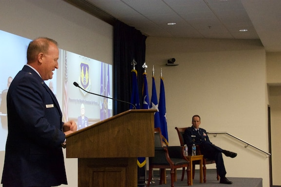 """Brig. Gen. Anthony W. """"Awgie"""" Genatempo, left, speaks to Maj. Gen. Shaun Q. Morris, right, during the Air Force Nuclear Weapons Center's ceremony where Genatempo assumed command from Morris. (Air Force photo by Capt. Matthew Rice)"""