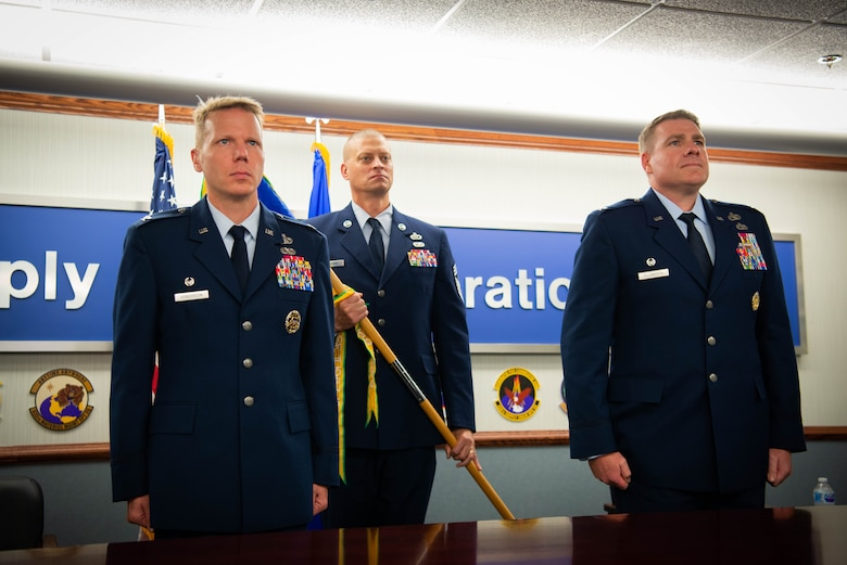 Col. Robert Henderson, out-going 635th Supply Chain Operations Wing commander, relinquishes command of the wing to Col. Chad Ellsworth, in-coming 635th SCOW commander, during a change of command ceremony at Scott Air Force Base, Illinois, July, 10, 2020.