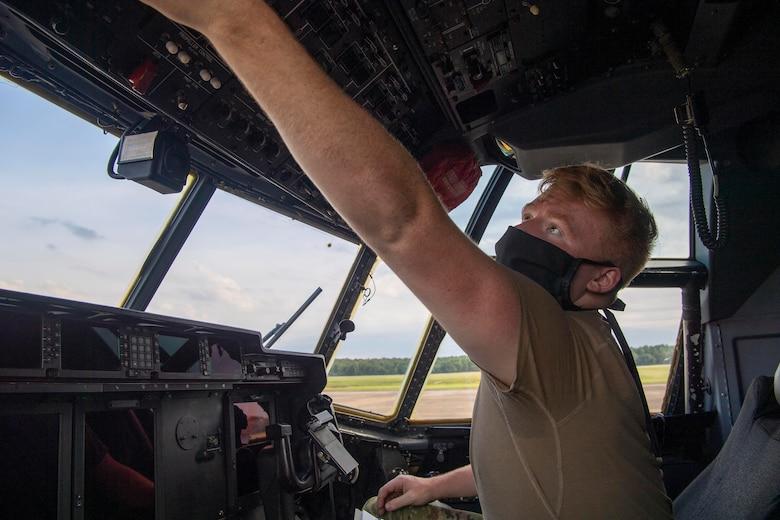 Senior Airman Matt Madson, 41st Airlift Squadron loadmaster, prepares a C-130J Super Hercules for the Herk Nation Stampede at Little Rock Air Force Base, Arkansas, July 14, 2020.