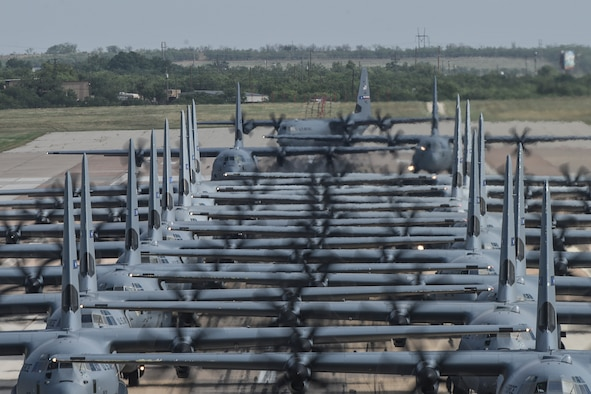 Multiple C-130J Super Hercules aircraft from the 317th Airlift Wing line up for takeoff during a Joint Forcible Entry exercise at Dyess Air Force Base, Texas, July 14, 2020.