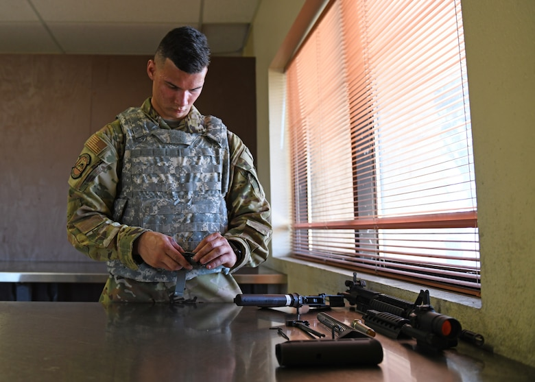 Airman 1st Class Nicholas Chapin, 9th Civil Engineering Squadron firefighter, disassembles an M4 Carbine for cleaning during a Combat Arms Training and Maintenance (CATM) course, June 22, 2020, at Beale Air Force Base California. The CATM course educates Airmen on how to properly operate and maintain weapons for forward deployed operations and for those who carry weapons everyday as part of their duties on the installation. (U.S. Air Force photo by Airman 1st Class Luis A. Ruiz-Vazquez)