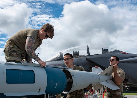 Airmen from the 4th Munitions Squadron assemble a Guided Bomb Unit-31 during a quarterly load crew competition at Seymour Johnson Air Force Base, North Carolina, July 10, 2020.