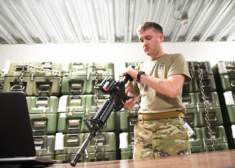 Senior Airman Richard Mitchell, 9th Security Forces Squadron combat arms instructor, inspects an M4 Carbine, June 23, 2020, at Beale Air Force Base California. Recce Town's combat arms instructors conduct weapon inspections regularly to ensure weapons are in proper working condition. (U.S. Air Force photo by Airman 1st Class Luis A. Ruiz-Vazquez)