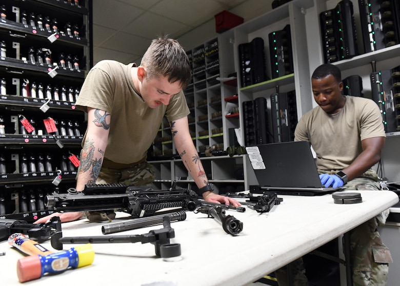 Senior Airman Richard Mitchell, 9th Security Forces Squadron combat arms instructor (left), and Staff Sgt. Ansumana Turray, 9th SFS assistant NCOIC of combat arms, conduct a weapon inspection at the Security Forces armory, June 26, 2020, at Beale Air Force Base California. Combat arms instructors ensure all Recce Town weapons are in working condition. (U.S. Air Force photo by Airman 1st Class Luis A. Ruiz-Vazquez)