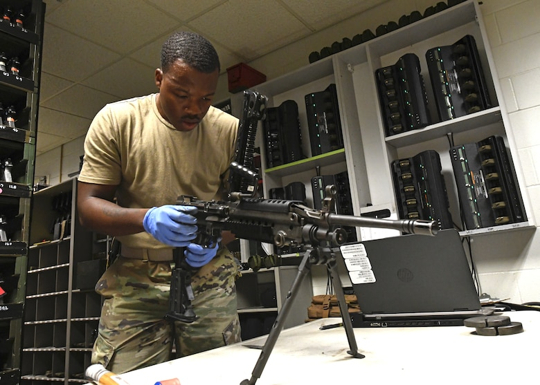Staff Sgt. Ansumana Turray, 9th Security Forces Squadron assistant NCOIC of combat arms, inspects an M249 Light Machine Gun, June 26, 2020, at Beale Air Force Base California. Recce Town's combat arms instructors conduct weapon inspections regularly to ensure they are in working condition. (U.S. Air Force photo by Airman 1st Class Luis A. Ruiz-Vazquez)
