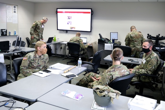 Soldiers from the 432nd Civil Affairs Battalion work at a civil military operations center as part of the cumulative training exercise July 14, 2020, in preparation for an upcoming overseas deployment. These Soldiers are some of the first to begin in-person training following the guidelines of the Centers for Disease Control and the Department of Defense.