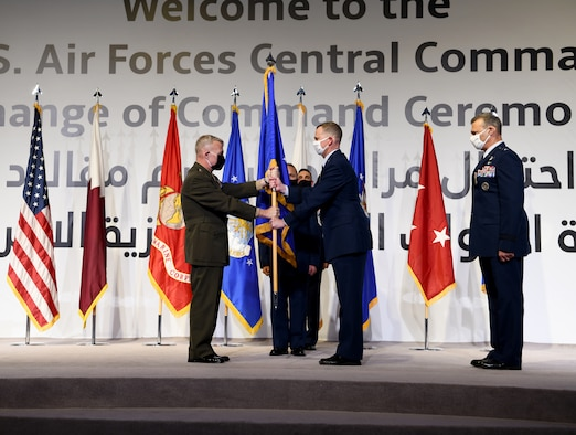 U.S. Air Force Lt. Gen. Gregory Guillot, incoming commander of U.S. Air Forces Central Command, accepts command from U.S. Marine Corps Gen. Kenneth McKenzie, commander of U.S. Central Command, during a change of command ceremony at Al Udeid Air Base, Qatar, July 16, 2020.