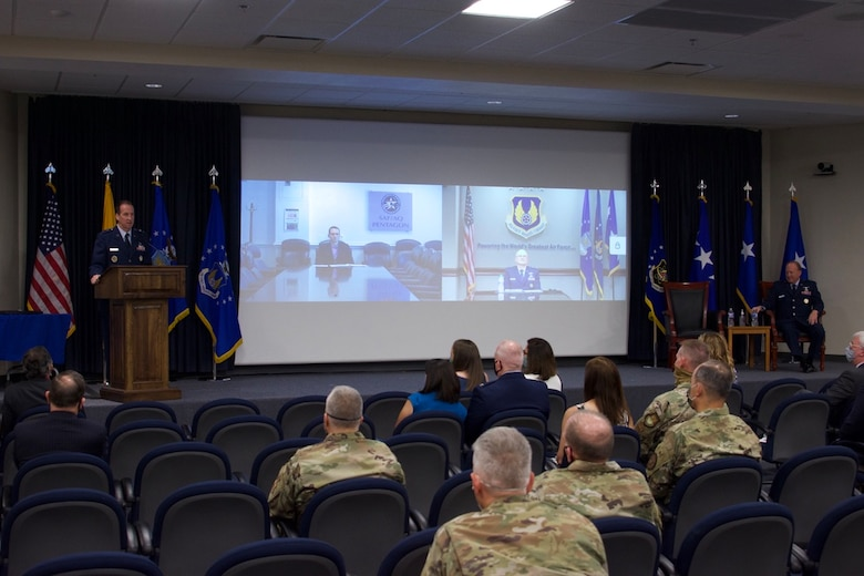 "Brig. Gen. Anthony W. ""Awgie"" Genatempo, right, took command of the Air Force Nuclear Weapons Center during a ceremony June 26 at Kirtland AFB, New Mexico. He succeeds Maj. Gen. Shaun Q. Morris, left, who took command of AFNWC in October 2017. Gen. Arnold W. Bunch, Jr., commander, Air Force Materiel Command, on right of screen projection, virtually presided over the center's change-of-command ceremony. Dr. Will Roper, Air Force assistant secretary for acquisition, technology and logistics, on left of screen, virtually presided over the change in leadership for the Air Force program executive officer for strategic systems, a dual-hatted position for the center commander. (Air Force photos by Capt. Matthew Rice)"