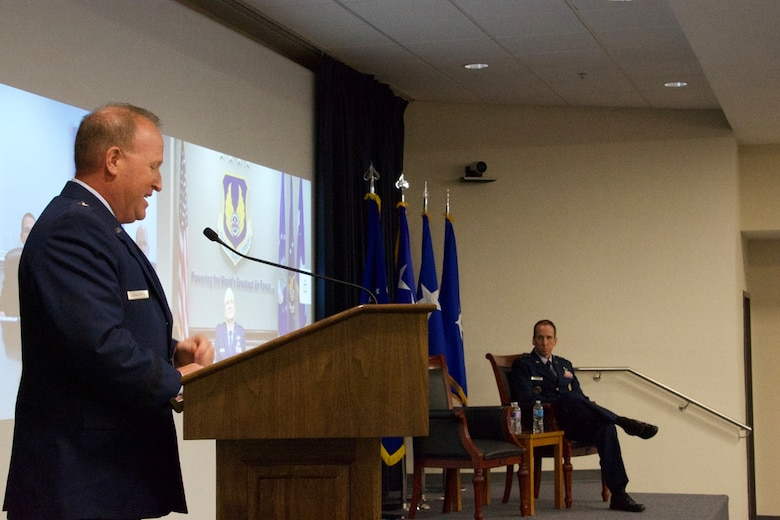"Brig. Gen. Anthony W. ""Awgie"" Genatempo, left, speaks to Maj. Gen. Shaun Q. Morris, right, during the Air Force Nuclear Weapons Center's ceremony where Genatempo assumed command from Morris. (Air Force photo by Capt. Matthew Rice)"