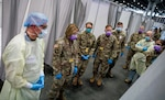 Lt. Gen. Laura Richardson (second from left), commander of U.S. Army North, views the patient area of the intensive care unit at the Javits New York Medical Station, April 12, 2020. While the peak of her command's COVID-19 response has passed, Richardson recently said it remains poised to step up and help should the need arise.