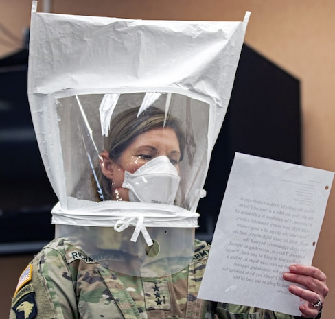 Lt. Gen. Laura Richardson, commander of U.S. Army North, goes through the safety precautions before entering the patient ward of the Edison Field Medical Site in Edison, N.J., April 13, 2020.