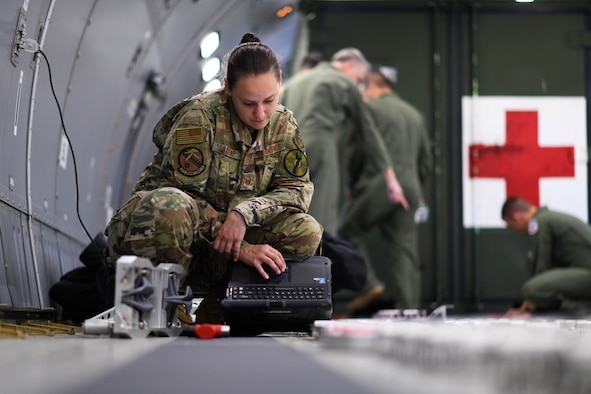 Tech. Sgt. Leah Oakleaf, 931st Aircraft Maintenance Squadron crew chief assigned to McConnell Air Force Base, Kansas reviews her technical order for configuration plans of the fuselage cargo palette locks July 11, 2020 at Travis Air Force Base, California. Rapid response from vendors to create quality replacement for parts such as cargo locks and outlets played a key role in resolving deficiencies that previously withheld the KC-46A Pegasus from operating as an aeromedical evacuation aircraft.  (U.S. Air Force photo by Airman 1st Class Nilsa Garcia)