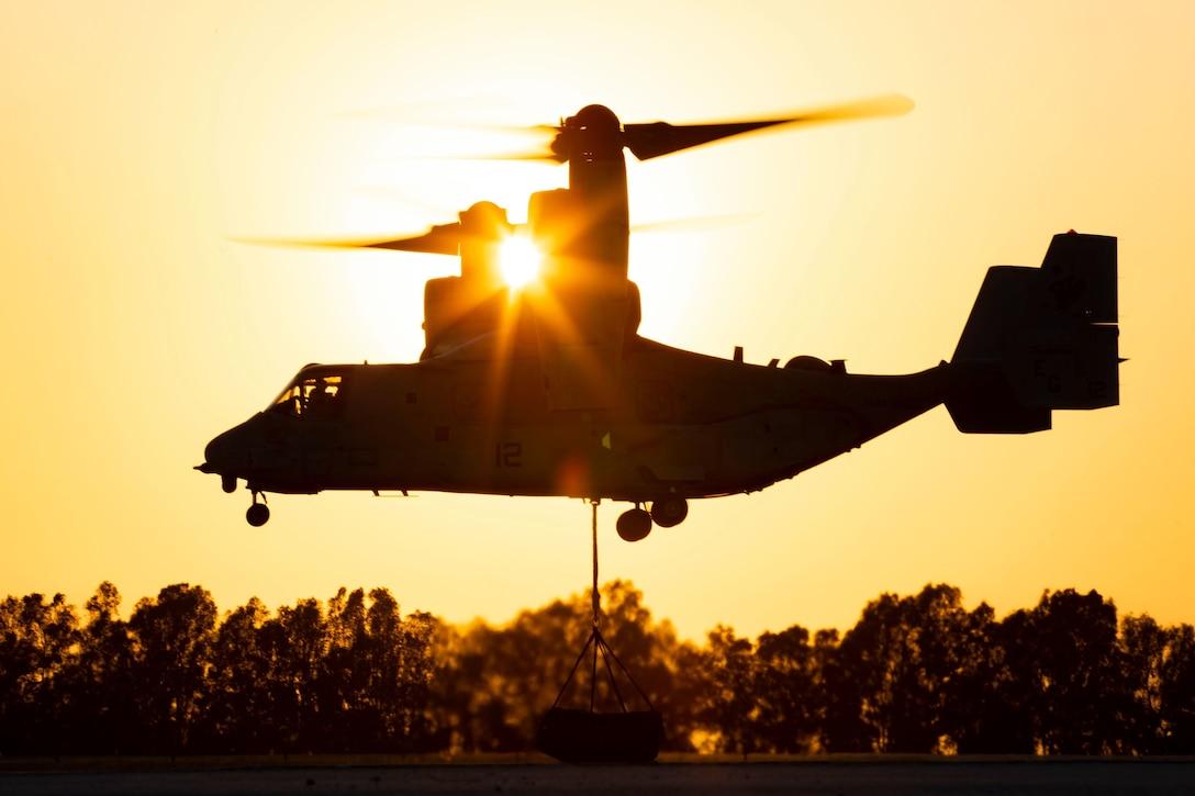 An MV-22B Osprey hoists a cargo net of tires during an external-lift exercise aboard at Morόn Air Base, Spain, July 9.