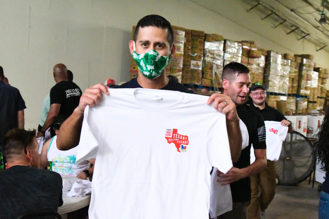Citizen Airmen enjoy local food and complimentary t-shirts from Tarrant Area Food Bank.