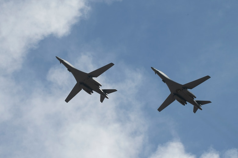 Two B-1B Lancers, assigned to the 28th Bomb Wing, Ellsworth Air Force Base, S.D., conduct a flyover before landing at Andersen AFB, Guam, July 17, 2020. The Bomber Task Force is deployed to Andersen AFB in support of Pacific Air Forces' training efforts with allies, partners and joint forces. (U.S. Air Force Photo by Airman 1st Class Christina Bennett)