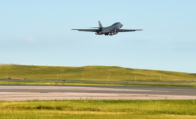 A B-1B Lancer assigned to the 37th Bomb Squadron launches from Ellsworth Air Force Base, S.D., for a Bomber Task Force (BTF) deployment to the U.S. Indo-Pacific Command area of responsibility, July 16, 2020. Bomber Task Force missions help maintain global stability and security while enabling units to become familiar in different regions. (U.S. Air Force photo by Airman 1st Class Quentin K. Marx)