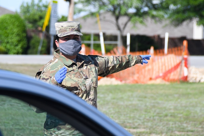 Citizen Airman directs traffic for provision distribution during COVID-19 response in Saginaw, Texas.