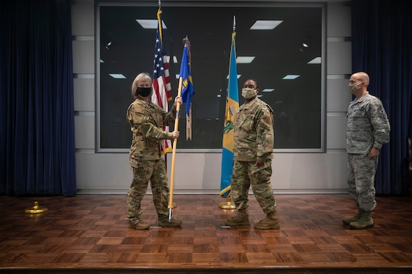 Outgoing 166th Airlift Wing Command Chief Master Sgt. William J. Horay, Jr., right, looks on as his successor, Command Chief Master Sgt. Robbin D. Moore, is introduced during their change of authority ceremony held at the New Castle ANG Base, Del. on July 12, 2020.