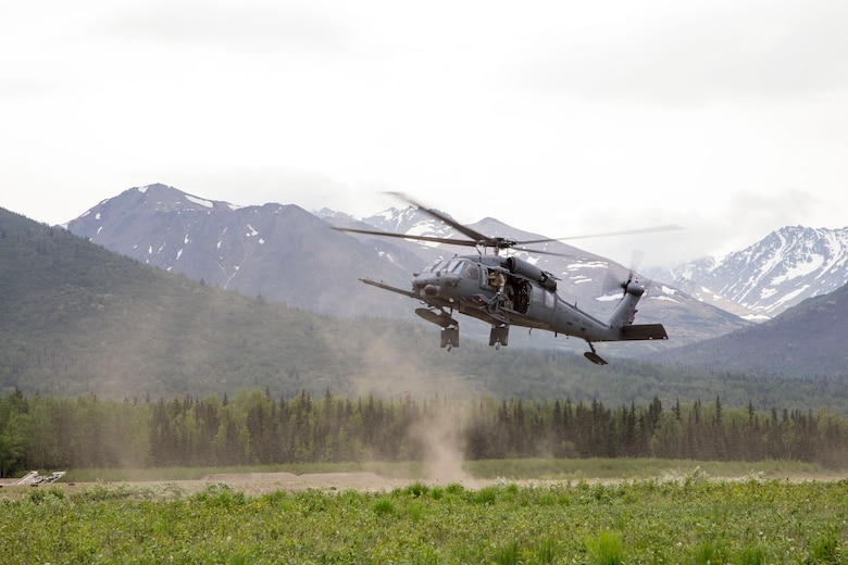 An Alaska Air National Guard 210th Rescue Squadron HH-60 Pave Hawk helicopter hovers during fast-trope training at Bryant Army Airfield on Joint Base Elmendorf-Richardson May 29, 2014. The 210th Rescue Squadron provides emergency rescue services for the citizens of Alaska in addition to training for wartime combat search and rescue missions. (U.S. Army National Guard photo by Sgt. Balinda O'Neal)