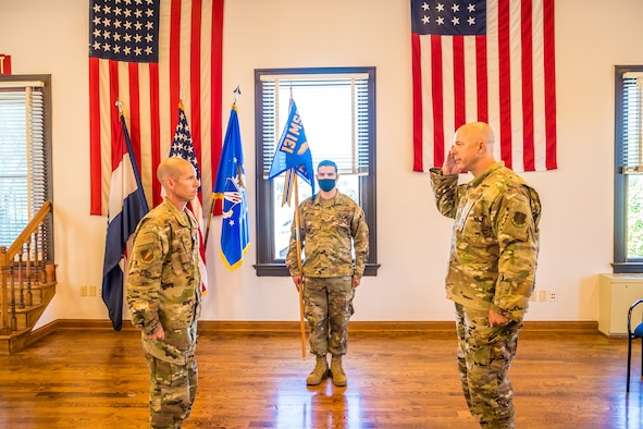Col. Darren Guttmann salutes 131st Bomb Wing Commander Col. Matthew Calhoun during an assumption of command ceremony at Jefferson Barracks Air National Guard Base, Mo., July 12, 2020. Guttmann assumed command of the 231st Civil Engineer Flight from Col. John Miget, who recently retired. (U.S. Air National Guard photo by Master Sgt. Stephen Froeber)
