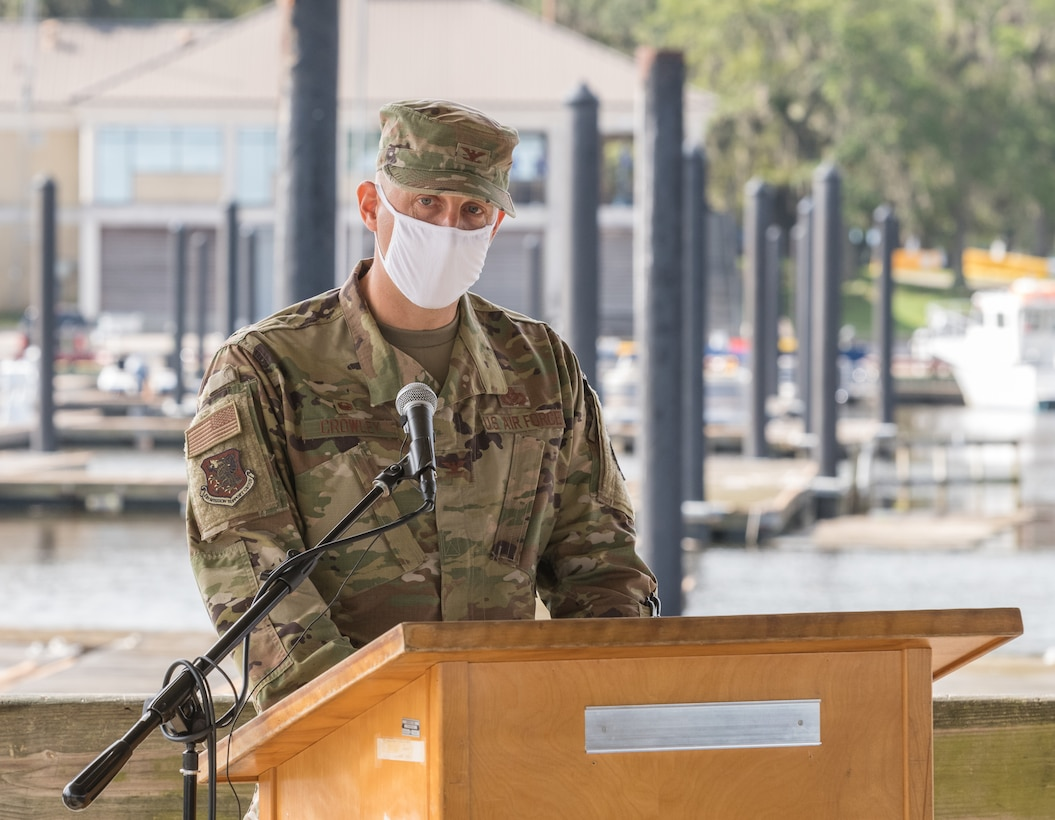 U.S Air Force Col. Ryan Crowley, incoming 81st Mission Support Group commander, addresses his new command during the 81st MSG change of command ceremony at the Marina Park at Keesler Air Force Base, Mississippi, July 16, 2020. The ceremony is a symbol of command being exchanged from one commander to the next by the handing-off of a ceremonial guidon. (U.S. Air Force Photo by Andre' Askew)