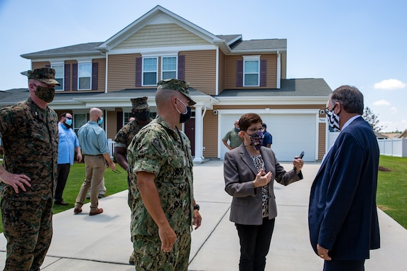 Nina McBroom, center, regional program housing manager, Marine Corps Installations East-Marine Corps Base Camp Lejeune briefs Charles A. Williams, Jr., right, assistant secretary of the Navy for Energy, Installations and Environment, on military housing in the Heroes Manor community during a tour on MCB Camp Lejeune, July 14, 2020. Williams visited MCB Camp Lejeune and Marine Corps Air Station New River to receive an update on military construction from installation leaders and view hurricane related repairs to facilities and family housing currently in progress. (U.S. Marine Corps photo by Lance Cpl. Christian Ayers)