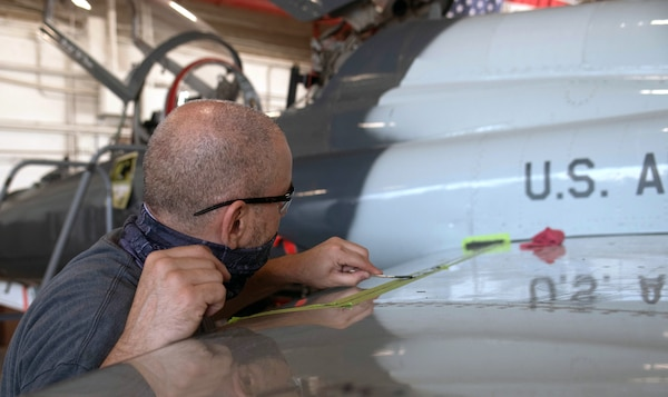 Scott Matthews, 12th Maintenance Squadron crew member, seals a T-38C wing to prevent corrosion at Joint Base San Antonio-Randolph July 14.
