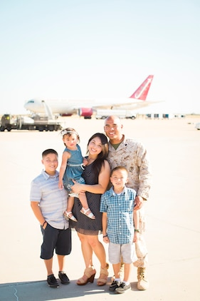 Staff Sgt. Fructuoso Santos poses with his childhood friend and wife, Tiana, and their three children at Marine Corps Air Station Miramar, California. The Santos family resides in Statesboro, Georgia, where Santos serves as a canvasing recruiter with Recruiting Station Columbia.