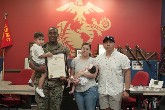 Marine Staff Sgt. Christopher Kelley poses with his family on June 1, 2020, after being promoted to his current rank. Kelley, 27, from Montgomery, Alabama, currently serves the local Myrtle Beach community as a canvassing recruiter. (U.S. Marine Corps photo by Sgt. Joseph Jacob)