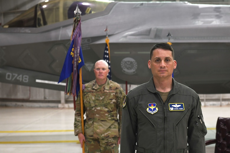Air Force Col. Byron Pompa, incoming 33rd OG commander, stands in front of the audience during the 33rd OG change of command at Eglin Air Force Base, Florida, July 17, 2020. The 33rd OG commander is responsible for leading a 390-person group comprised of the 33rd Operations Support Squadron, the 337th Air Control Squadron, two intelligence formal training units, and the 58th Fighter Squadron. (U.S. Air Force photo by Airman 1st Class Heather Leveille)
