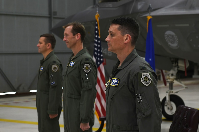 Air Force Col. Jon Wheeler, left, 33rd Fighter Wing commander, Col. Brian O'Neill, middle, outgoing 33rd Operations Group commander, and Col. Byron Pompa, incoming 33rd OG commander, right, stand at attention, during the 33rd OG change of command at Eglin Air Force Base, Florida, July 17, 2020. The change of command is the military's formal transfer of command responsibility from one commander to the next. (U.S. Air Force photo by Airman 1st Class Heather Leveille)