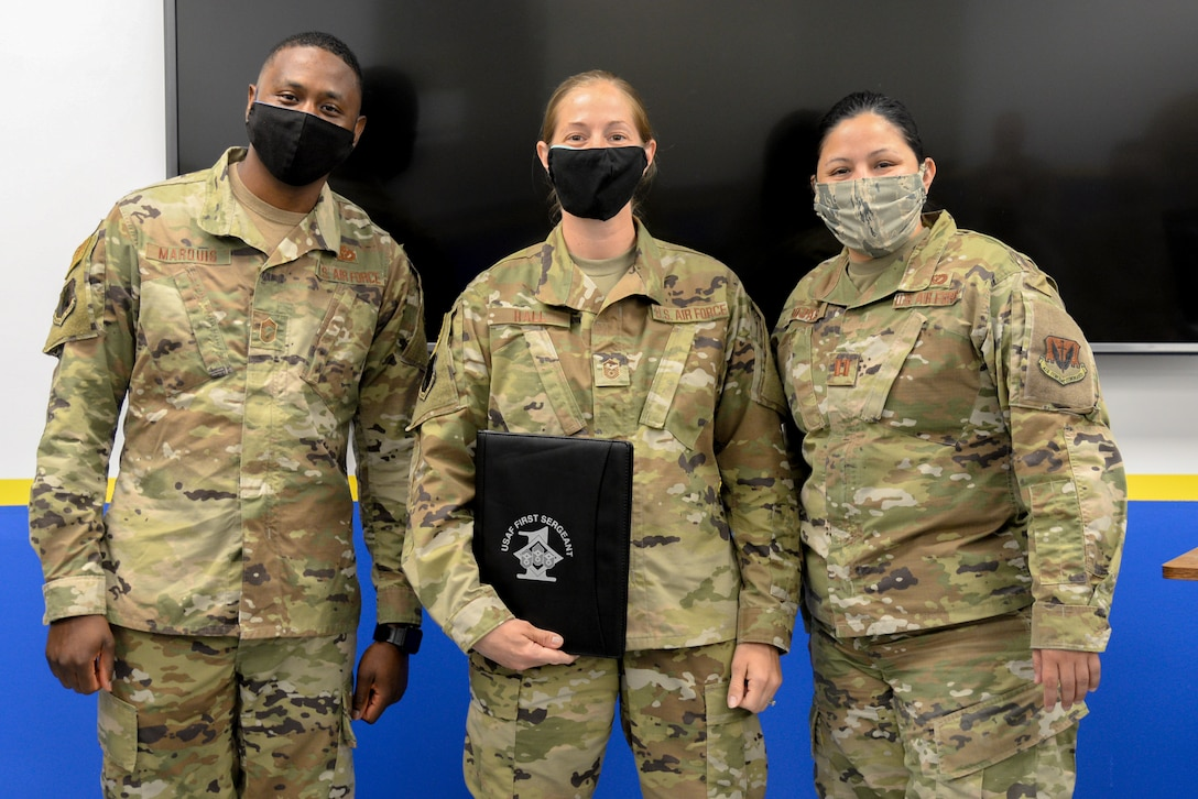 A photo of Chief Master Sgt. Litchroy Marquis, Master Sgt. Jennifer L. Hall and Capt. Natalia Rojas posing for a photo.