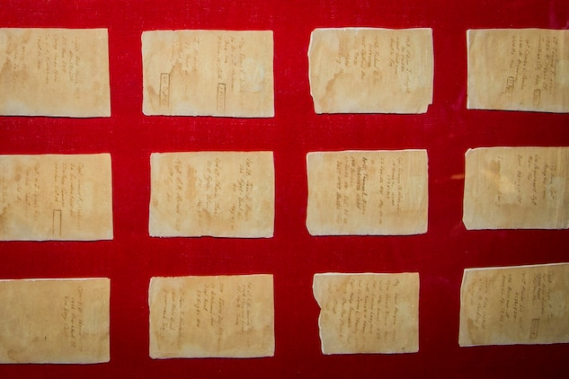 Cigarette papers used by U.S. Marine POW's during the Korean war for providing information on Marines who were captured are displayed prior to a collection transfer at warehouse 2288, Marine Corps Base (MCB) Camp Pendleton, California, Jan. 10, 2019. Several Marine Corps artifacts were collected from the MCB Camp Pendleton History Museum Branch for transport to the National Museum of the Marine Corps in Triangle, Virginia. (U.S. Marine Corps photo by Cpl. Juan C. Bustos)