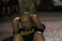 Warrant Officer Candidate performs the sit-up event during an Army Physical Fitness Test at Warrant Officer Candidate School at Fort McClellan, Alabama, July 7, 2020.