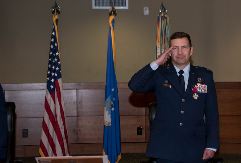 U.S. Air Force Col. Robert Davis renders a salute after receiving a Legion of Merit medal as he relinquishes command of the wing to U.S. Air Force Col. Travolis Simmons during the 3rd Wing change of command ceremony at Joint Base Elmendorf-Richardson, Alaska, July 17, 2020. The 3rd WG provides trained and equipped tactical air dominance forces, command and control platforms, and strategic and tactical airlift resources for contingency operations and also provides immediate early airborne detection, warning, surveillance and interception of hostile forces within the Alaskan North American Aerospace Defense Command Region. The ceremony was adapted to comply with COVID-19 health and safety measures.