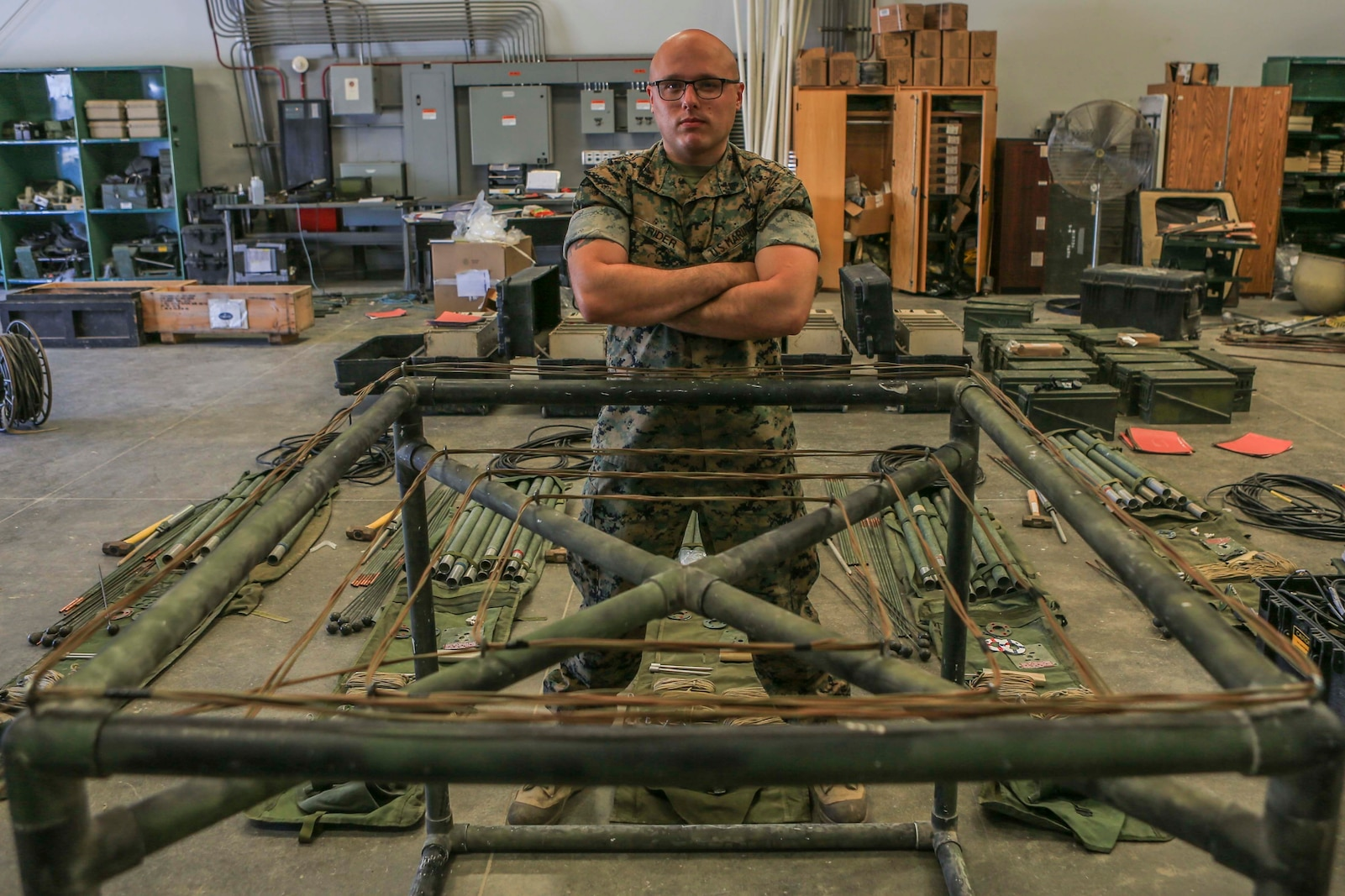 Cpl. Cameron Rider, a radio operator with Combat Logistics Regiment 1, 1st Marine Logistics Group, shows off his award winning antenna design after winning the 1st MLG Innovation Award, on Camp Pendleton, California, July 17, 2020. For his innovation, Rider utilized his previous experience and knowledge of constructing field-expedient antennas in his fabrication of a low-cost, vehicle-mounted antenna capable of maintaining on-the-move communication. (U.S. Marine Corps photo by Lance Cpl. Ulises Salgado)