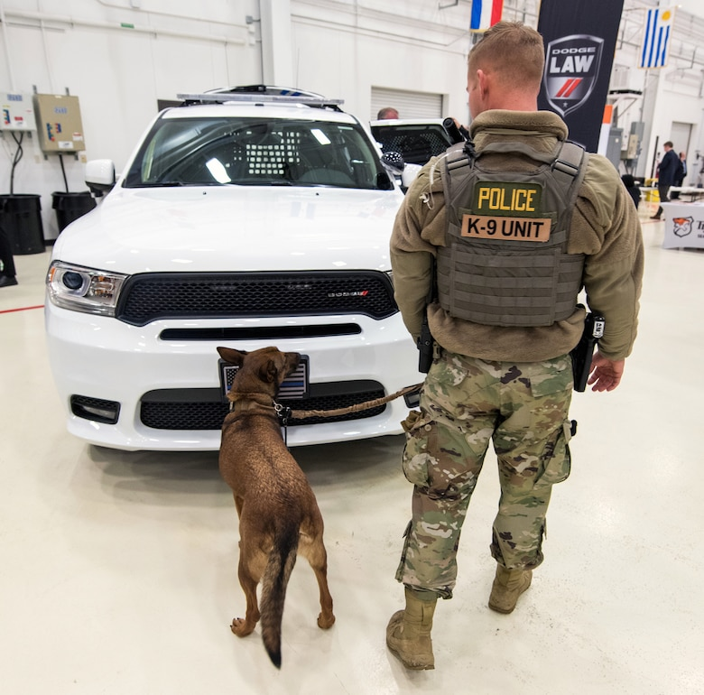 Air Force Staff Sgt. Tyler Evans, 802nd Security Forces Squadron, military working dog handler, and his dog Mika