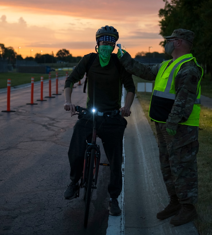 A U.S. Airman with the Indiana Air National Guard receives a temperature check while passing through a prescreening station June 14, 2020, at the 122nd Fighter Wing in Fort Wayne, Indiana. Temperature checks were conducted as an additional safety measure to help identify members with potential COVID-19 symptoms.