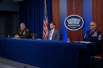 """Defense Secretary Dr. Mark T. Esper; Army Gen. Mark A. Milley, chairman of the Joint Chiefs of Staff; and Senior Enlisted Advisor to the Chairman Ramón """"CZ"""" Colón-López sit at a table."""